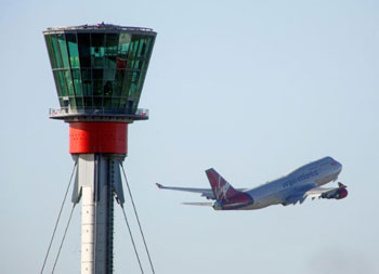 Air traffic control tower and aeroplane