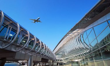 Plane flying over Incheon International Airport terminal