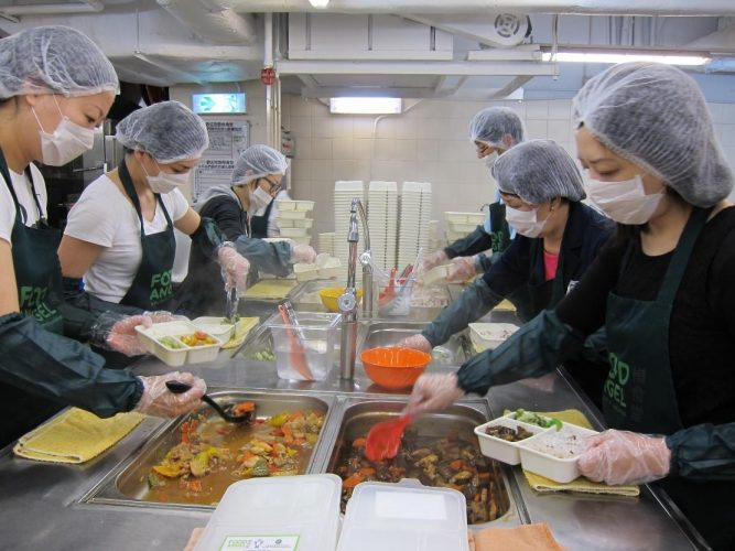 Preparing meals at Food Angel's community kitchen