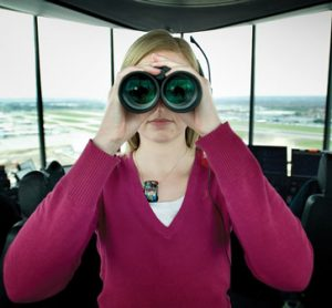 Using binoculars in an air traffic control tower